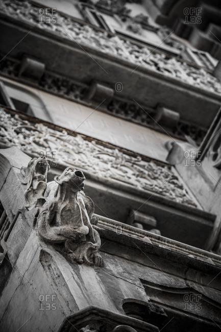 Gargoyle on the facade of a building in Barcelona, Catalonia, Spain