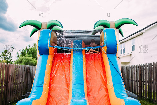 Boy at top of inflatable waterslide