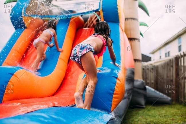 Kids playing on bouncy waterslide