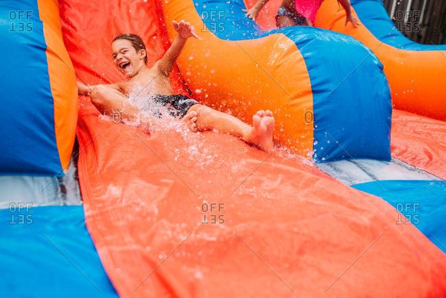 Boy going down waterslide