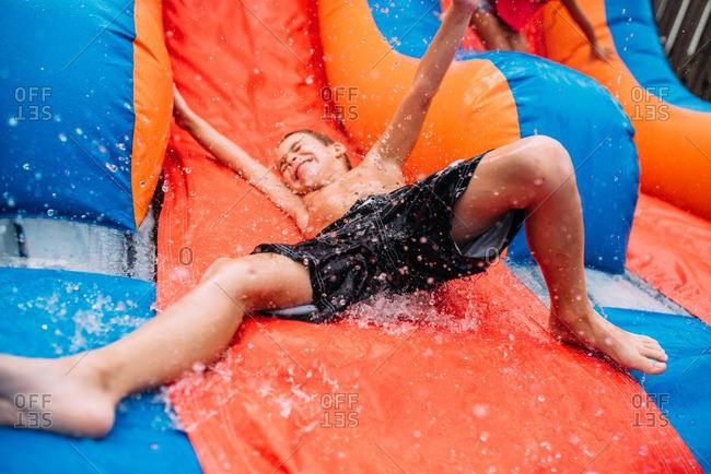 Boy going down a waterslide