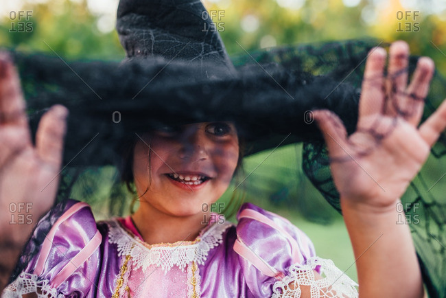 Girl playing with witch costume