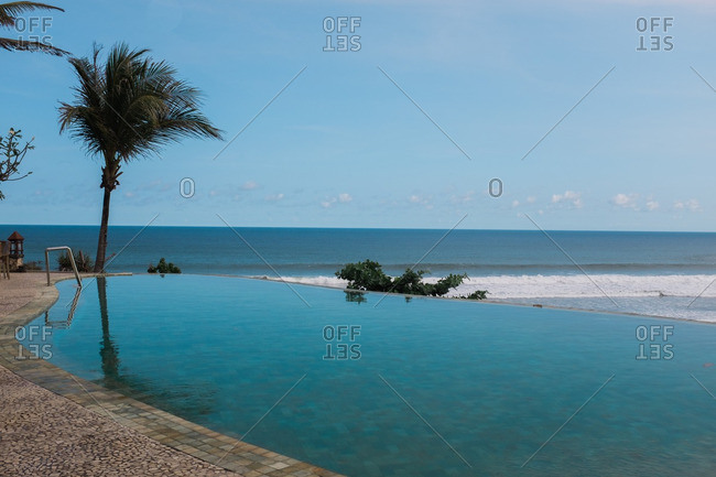 Infinity pool looking out over ocean in Central Java