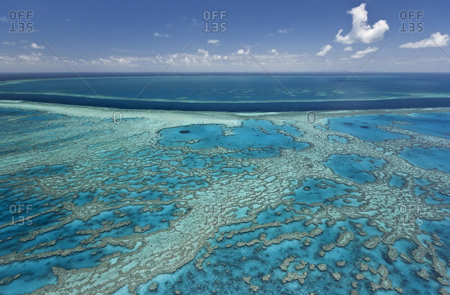 Aerial view of coral reefs in blue Pacific waters, Australia, Great Barrier Reef