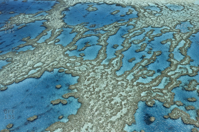 Aerial view of coral reef formations in the Great Barrier Reef, Australia