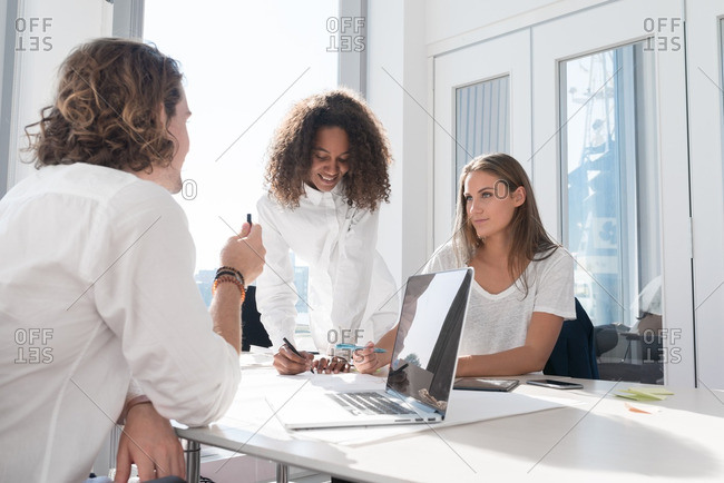 Co-workers collaborating in a business meeting