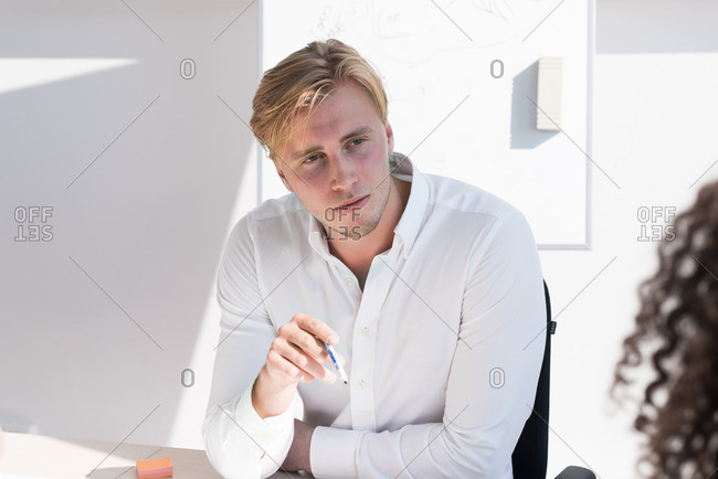 Man thinking in a business meeting