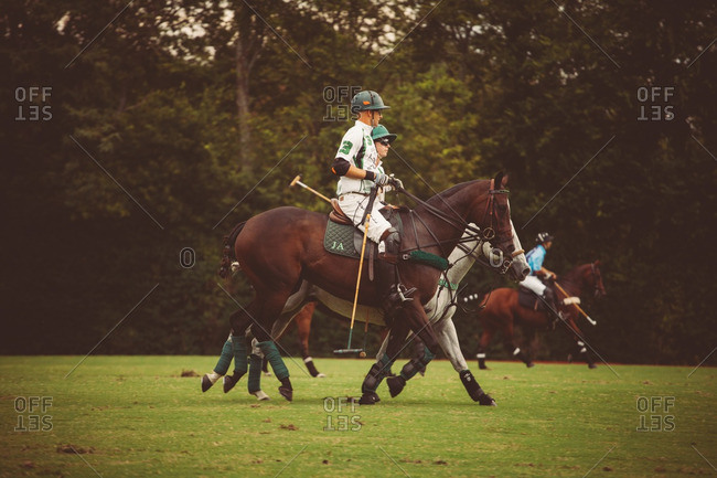 September 18, 2016: Polo players on a field during a match