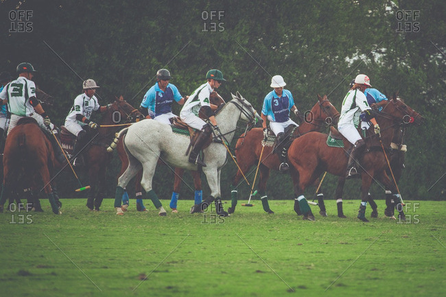 September 18, 2016: Players from two polo teams on a field during a match