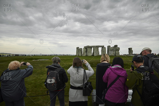 Wiltshire, England - May 7, 2016: Tourists taking photographs at Stonehenge in Wiltshire, England