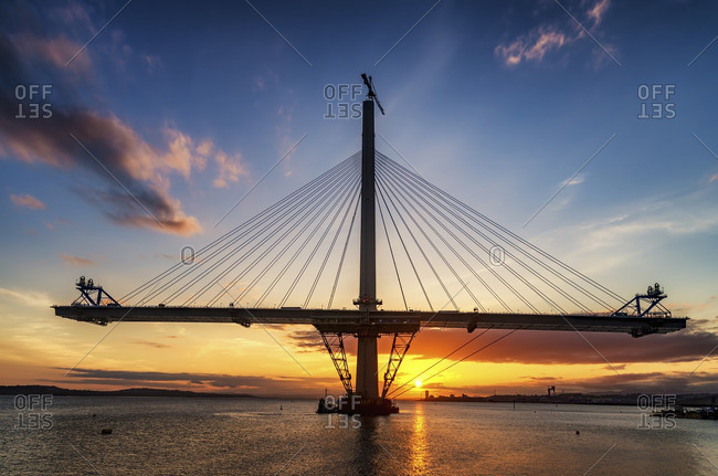Scotland, Construction of the Queensferry Crossing Bridge at sunset