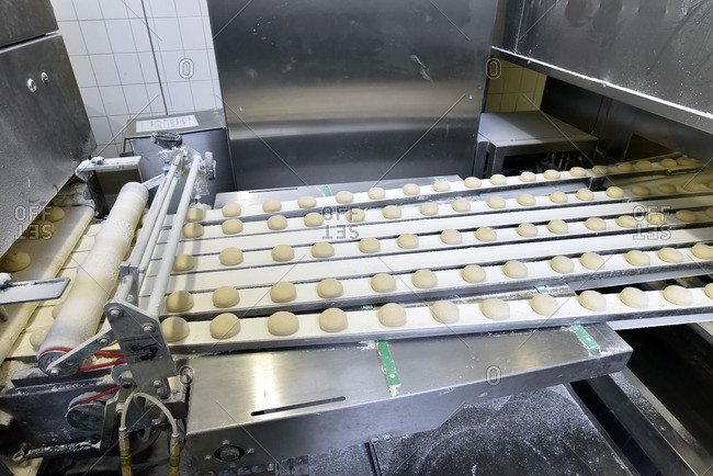 Production line in a baking factory with dough