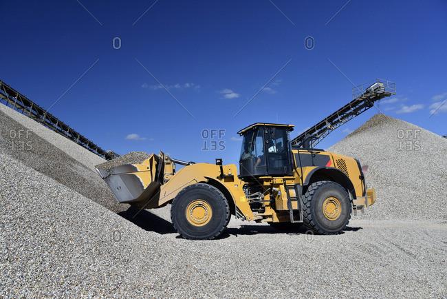 Wheel loader loading gravel in gravel pit