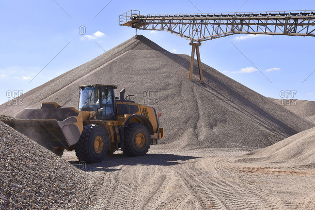 Wheel loader loading gravel in gravel pit