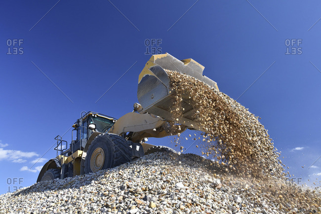 Wheel loader loading stones in gravel pit