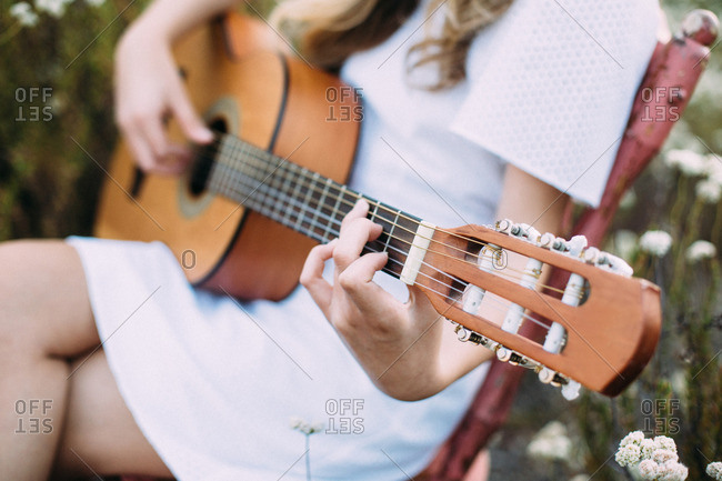 Young woman playing a guitar