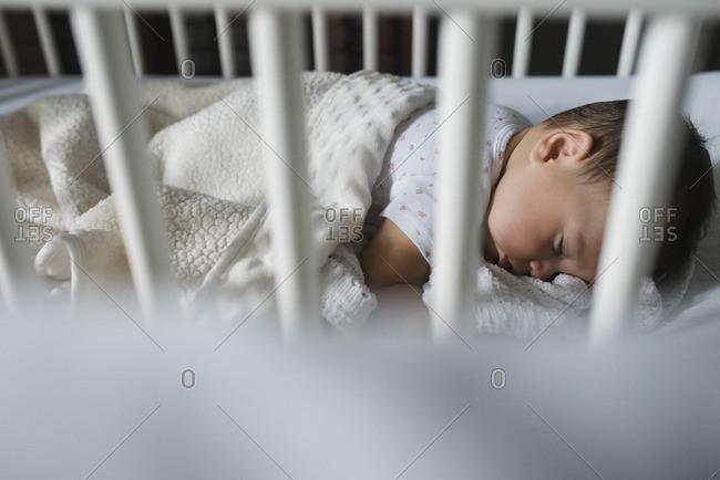 Baby asleep in her crib