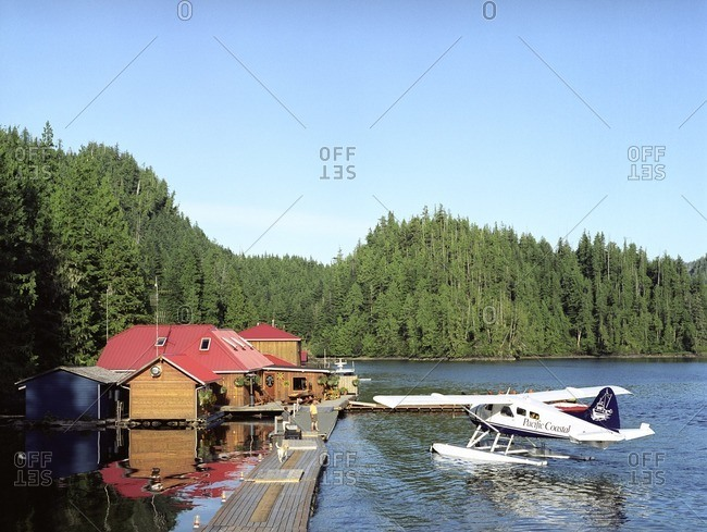 British Columbia, Canada - June 5, 2007: Seaplane landing at lake dock