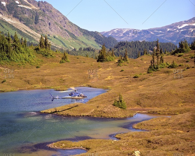 Helicopter over Canadian wilderness