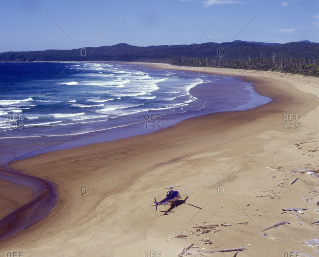 Helicopter landing on a beach