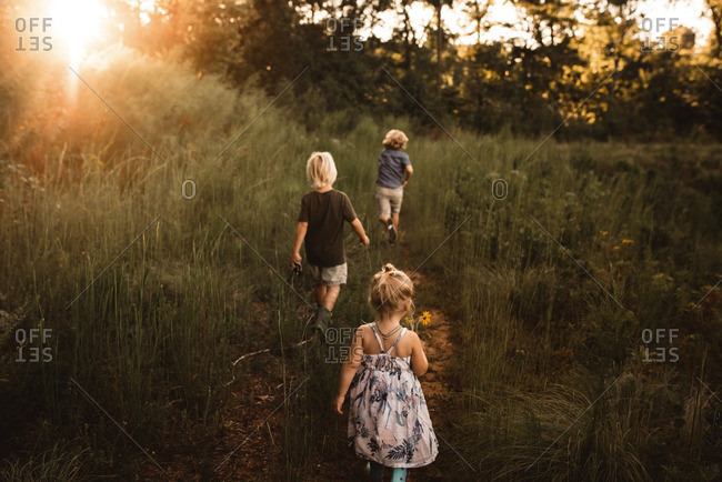 Girl and two boys in countryside