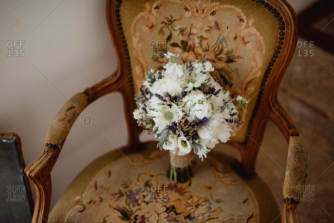 Bride's bouquet in an antique chair