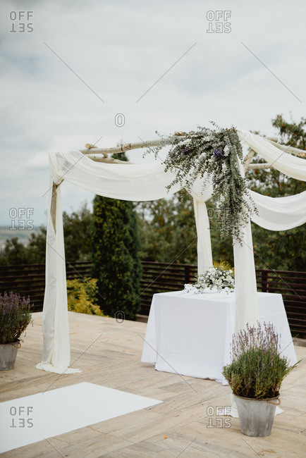 Wedding alter with draped fabric and flowers