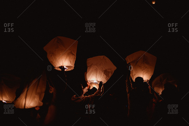 Guests Sending Sky Lanterns Into The Air At A Wedding Reception