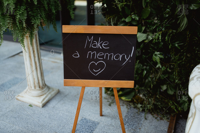 """Make a memory"" sign for a photo station at a wedding"
