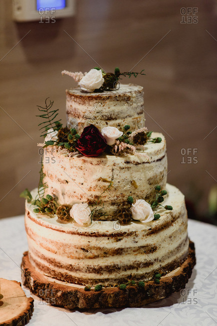 Rustic wedding cake decorated with flowers