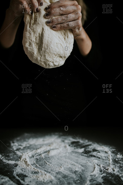 Woman holding a bunch of dough