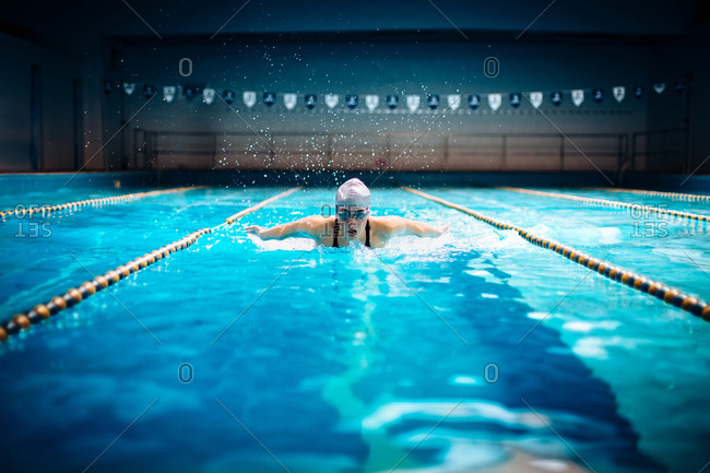 Woman swimming doing butterfly stroke