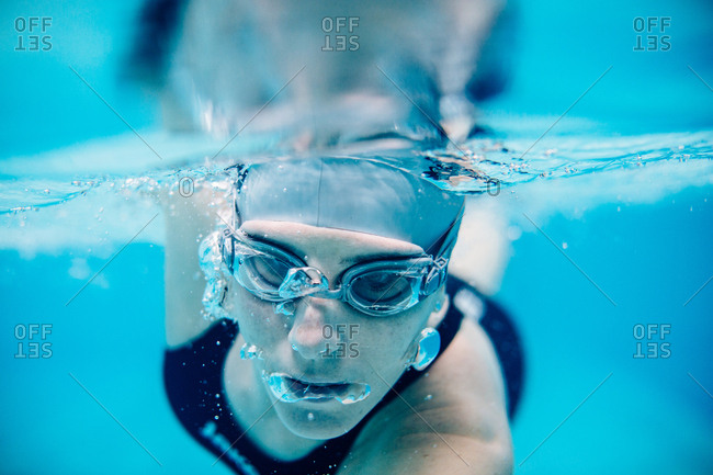 Underwater close up view of woman swimming