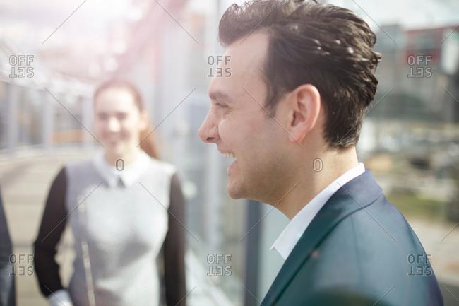Businessman and woman on city footbridge, London, UK