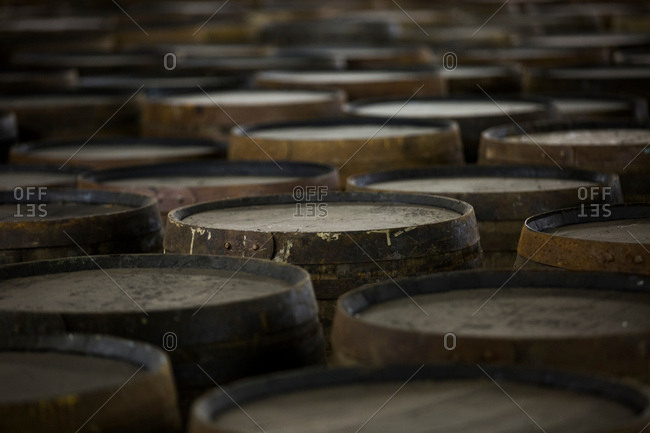 Rows of wooden whisky casks in whisky distillery