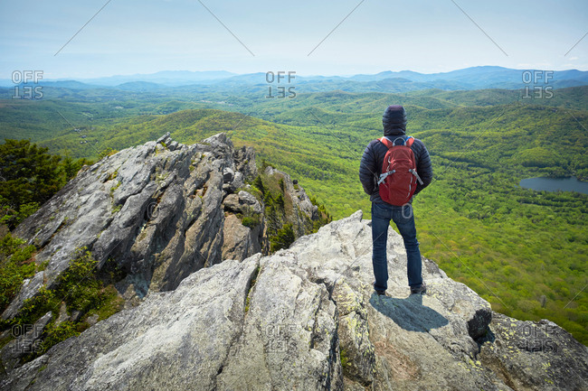 Rear view of male hiker looking out from ridge, Blue Ridge Mountains, North Carolina, USA