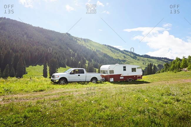 Recreational vehicle and caravan parked in landscape, Crested Butte, Colorado, USA