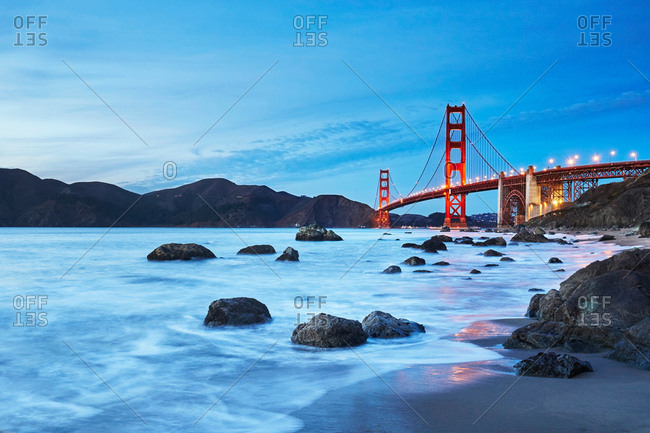 View of Golden Gate Bridge from Marshall's Beach at dusk, San Francisco, California,  USA