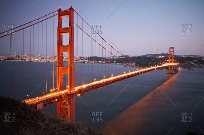 View of traffic light trails crossing Golden Gate Bridge at dusk, San Francisco, California,  USA