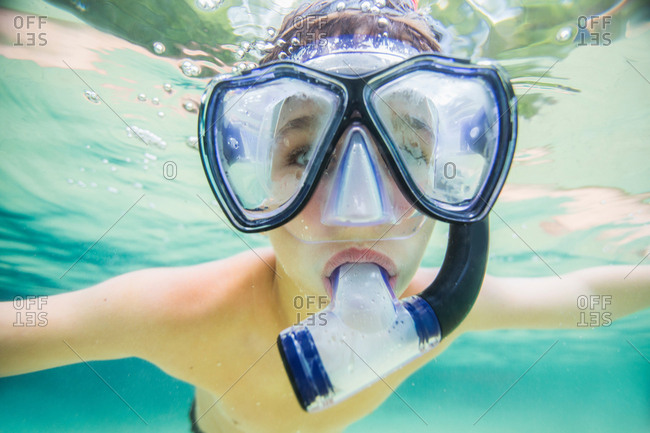 Boy snorkeling in clear spring water, Econfina Springs, Florida, USA