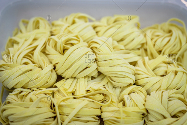 Detail of tagliatelle pasta in pasta factory