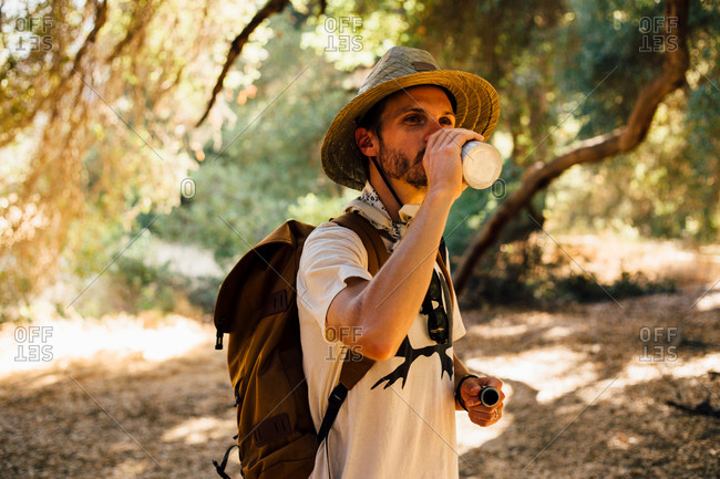 Hiker drinking from water bottle, Malibu Canyon, California, USA