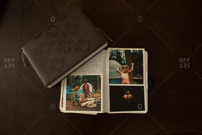 Photos and two journals on a table