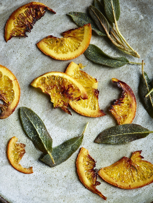 Roasted orange slices with sage leaves