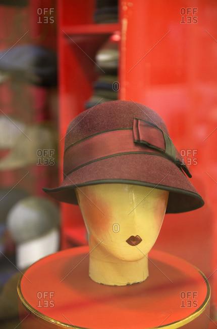 Mannequin head in hat shop window, Notting Hill, London