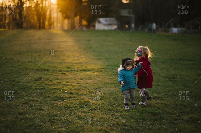 Siblings in a chilly rural yard