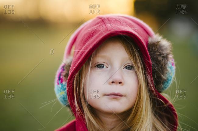 Girl in earmuffs and hood