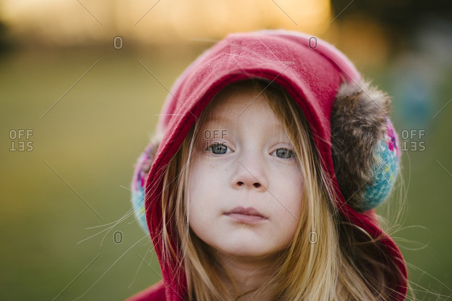 Girl in earmuffs standing outside
