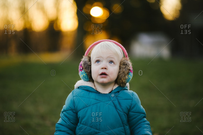 Toddler boy in earmuffs