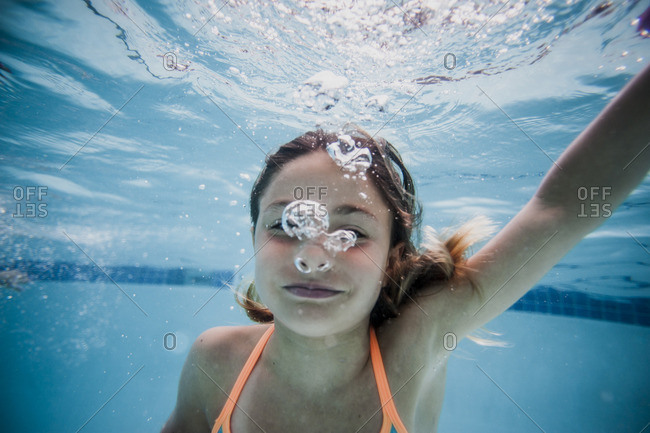 Underwater portrait of girl in a swimming pool